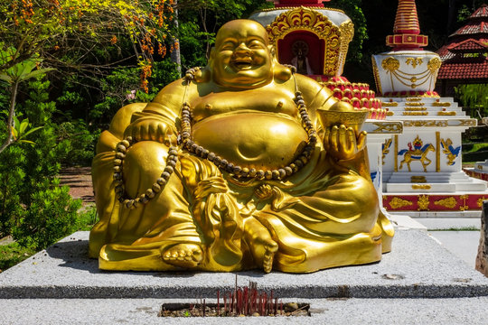 Lucky seated golden Buddha in Wat Wanararm or What Kho Wanararm Temple in Langkawi island, also known as Pulau Langkawi, State of Kedah, Malaysia.