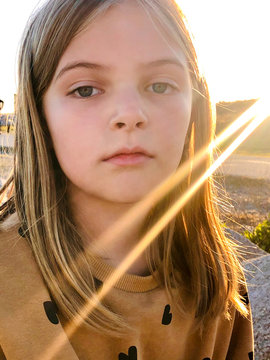 Portrait / face of young girl with sunbeams