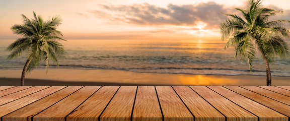 Zelfklevend Fotobehang Strand long wooden table with beach landscape blur background