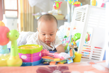 Cute Asian little baby playing Toys