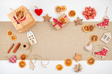 Zero waste Christmas with craft cardboard boxes, dried oranges, wooden and textile decoration,...
