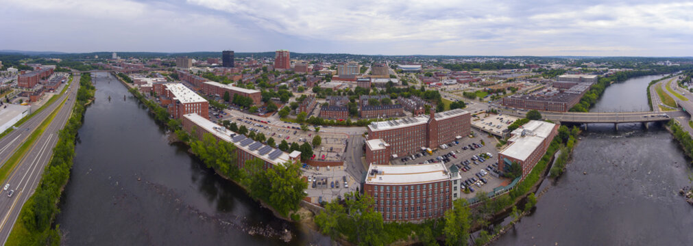 Manchester downtown building including City Hall Plaza and Brady Sullivan Plaza with Merrimack River in the front panorama aerial view, Manchester, New Hampshire, NH, USA.
