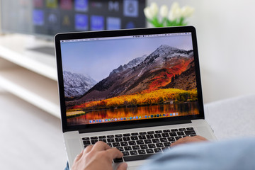 Backgrounds MacOS High Sierra in the screen of MacBook Pro