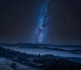Fototapete - Wonderful foggy walley and Tatra Mountains at night, Poland