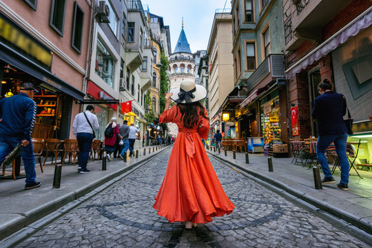 Woman standing at Galata tower in Istanbul, Turkey.