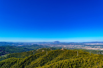 Foto auf Leinwand Dunkelblau Photograph of the mountains and meadows in Catalonia, taken from Mount Tibidabo