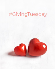 Giving Tuesday, global day of charitable giving. Black Friday of Charity, global charity campain. Two stone hearts on white textured background. Give help, donate to charities.
