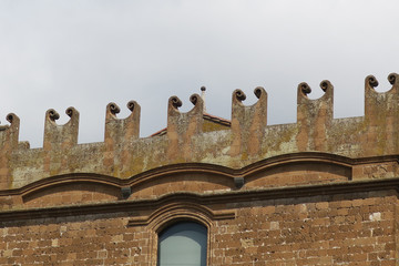 facade of a building with curling ornaments in Orvieto Italy