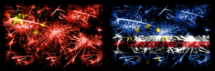 China, Chinese vs Cape Verde New Year celebration travel sparkling fireworks flags concept background. Combination of two abstract states flags. Fototapete