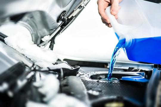 Pouring antifreeze.  Antifreeze liquid for washing car screen.
