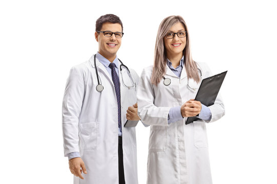 Young male and female doctors smiling
