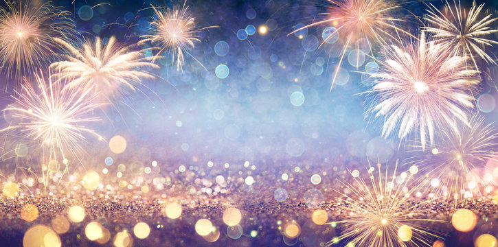 Abstract Golden Glitter Background With Fireworks