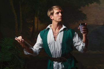 Young man in Renaissance style uses gadgets