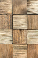 wooden background. Background of wooden squares. beige wood background. vertical photo