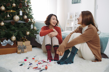 Portrait of pretty confident asian girlfriends make makeup during Holiday. Christmas time.
