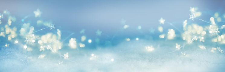 Abstract winter background with bokeh and stars  -  New year  -  Christmas backdrop  -  Xmas card with copy space