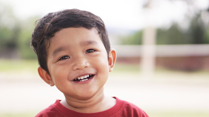 Happy Little Asian baby boy 2 years old. child Healthy happy funny smiling face young toddler lovely kid concept. Asian kid laugh looking at camera portrait.