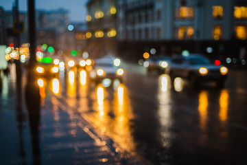 Spoed Foto op Canvas Nacht snelweg Wet night city street rain Bokeh reflection bright colorful lights puddles sidewalk Car