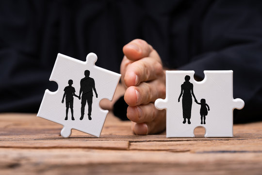 Dividing Two Jigsaw Puzzle Pieces Showing Divorce Concept
