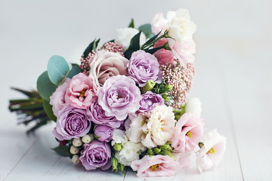beautiful delicate flower bouquet with roses, ranunculuses, eustomas and carnations