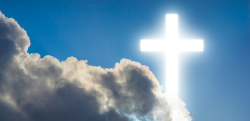 Religion catholic bright cross in the sky with clouds