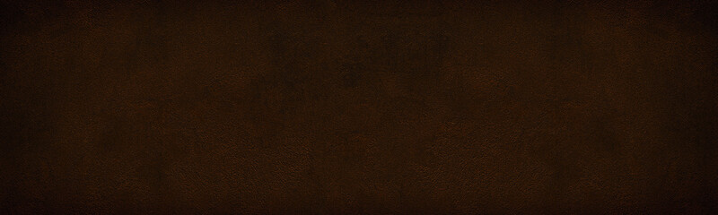 Wide dark bronze colored shabby cement plaster texture. Rough surface widescreen backdrop. Large grunge background