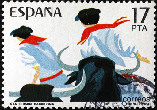 Running of the bulls in Pamplona on spanish postage stamp