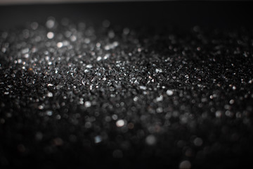 Monochrome abstract background with bokeh defocused lights.