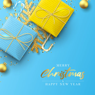 Christmas and New Year holday card. Festive background with realistic blue and yellow gift boxes, candy canes, Christmas balls, gold confetti and snowflake. Vector illustration.