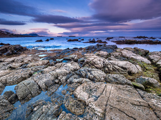 Rocky coastline in the Strait of Gibraltar, near Algeciras, Spain, during blue hour