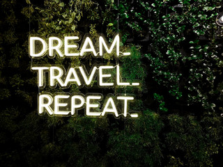 """Dream, Travel, Repeat"" quote - Neon cool inspiring quote about travel and dreams"