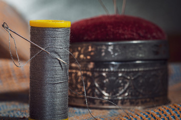 needle and thread sewing.