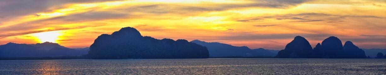 Islands Sunset, Ocean panorama views near Phuket with deep Red, Orange, Purple and Blue, mountains, twilight in Thailand. Including Phi Phi, Ko Rang Yai, Ko Li Pe and other islands. Asia. Wall mural