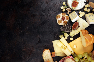 Different sorts of cheese. Cheese platter with different cheese and spice