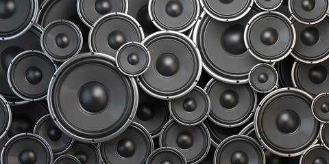 Acoustic sound speakers background. Black subwoofers of different size. Multimedia, audio and sound concept.