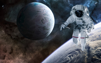 Astronaut, planets of deep space against background of nebulae. Science fiction. Elements of this image furnished by NASA
