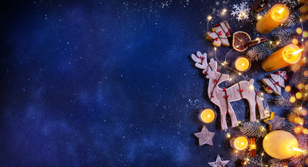 Christmas background with wooden decorations and candles. Free space for text