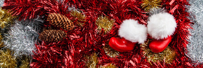 Christmas panorama / banner - Santa's boots design for festive cheer, with red, gold and silver tinsel for extra sparkle.
