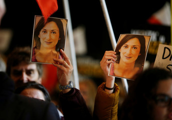 People carry photos of assassinated anti-corruption journalist Daphne Caruana Galizia during an anti-corruption protest against the government of Prime Minister Joseph Muscat, in Valletta