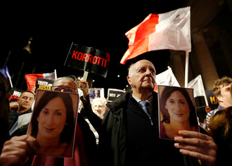 Rose and Michael Vella carry photos of their daughter, assassinated anti-corruption journalist Daphne Caruana Galizia, during an anti-corruption protest against the government of Prime Minister Joseph Muscat, in Valletta