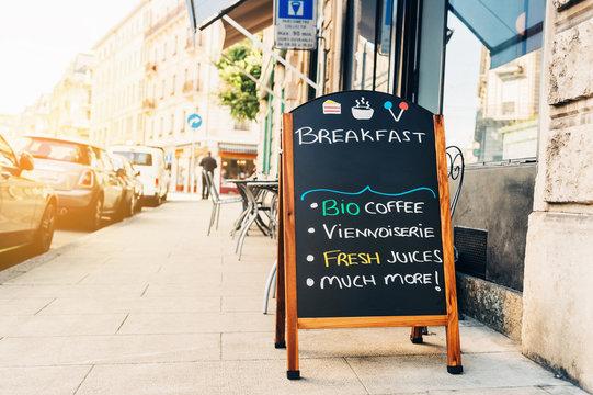 Street menu next to cafe. Exterior coffee shop.