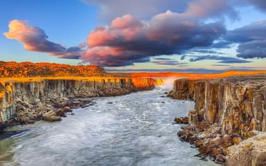 Wall Mural - Dramatic sunset view of fantastic waterfall and cascades of Selfoss waterfall.