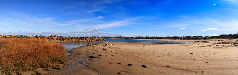 Blue skies over Corporation Beach in Dennis, Massachusetts on Cape Cod