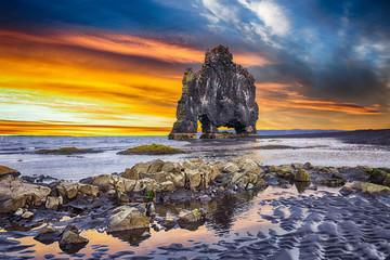 Dramatic sunset view of fHvitserkur unique basalt rock in Iceland