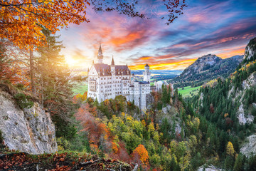Majestic sunset view of famous Neuschwanstein Castle in autumn. Wall mural