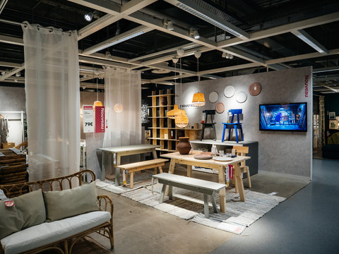 PARIS, FRANCE - JUN 7, 2018: View of stylish dining zone composed in furniture shop Ikea with multiple accessories and furniture