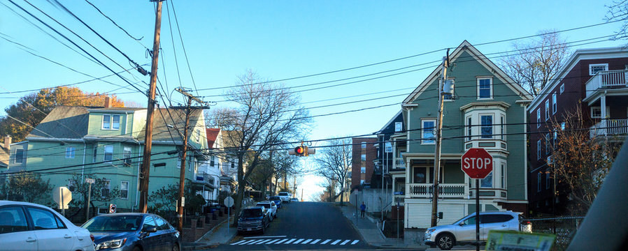 Tree-lined street in a rural Somerville neighborhood in the Fall in the outskirts of Boston.
