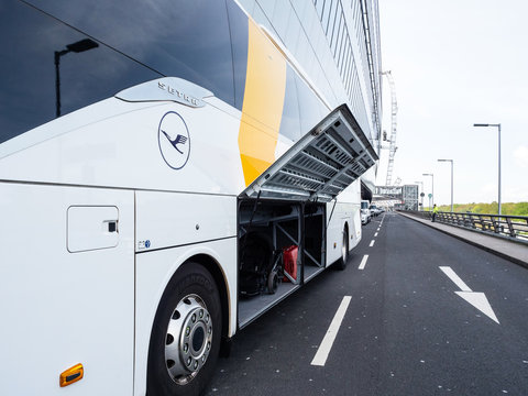 Frankfurt, Germany - Apr 29, 2019: Open luggage door of Luxury Setra Lufthansa Express bus coach parked outdoor the Terminal Frankfurt International Airport near Squaire entrance