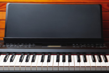 digital piano keys with music stand, copy-space background