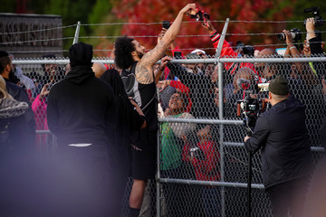 Kaepernick signs autographs at a special training event at Charles. R. Drew High School in Riverdale